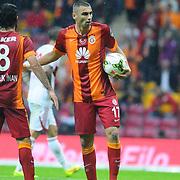 Galatasaray's Burak Yilmaz (R) during their Turkish Super League soccer match Galatasaray between Sivasspor at the TT Arena at Seyrantepe in Istanbul Turkey on Friday, 26 September 2014. Photo by Kurtulus YILMAZ/TURKPIX