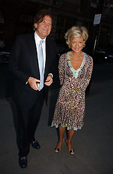 JOHN MADEJSKI and JANIE MACLELLAN at an exhibition of photographs by Lord Snowdon held at the Chris Beetles Gallery, Ryder Street, London on 18th September 2006.<br /><br />NON EXCLUSIVE - WORLD RIGHTS