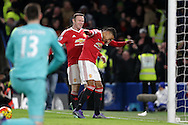 Jesse Lingard of Manchester United ® celebrates with Wayne Rooney, the Manchester United captain after scoring his teams 1st goal to make it 0-1. Barclays Premier league match, Chelsea v Manchester Utd at Stamford Bridge in London on Sunday 7th February 2016.<br /> pic by John Patrick Fletcher, Andrew Orchard sports photography.