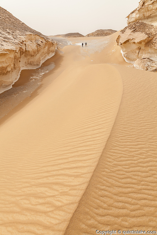 Trekking above a large sand dune in the White Desert), Egypt