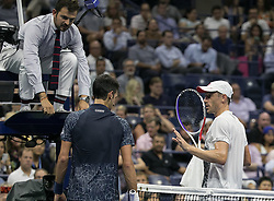 September 5, 2018 - Flushing Meadows, New York, U.S - Novack Djokovic and John Millman agree to request from the court umpire the invocation of the 'Equipment Out of Adjustment' rule due to excessive sweat by both players on Day 10 of the 2018 US Open at USTA Billie Jean King National Tennis Center on Wednesday September 5, 2018 in the Flushing neighborhood of the Queens borough of New York City. Djokovic changes shirt. Novack Djokovic defeats Millman, 6-3, 6-4, 6-4. (Credit Image: © Prensa Internacional via ZUMA Wire)