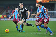 Andy Kellett of Wigan Athletic under attack from scunthorpe united players  during the Sky Bet League 1 match between Scunthorpe United and Wigan Athletic at Glanford Park, Scunthorpe, England on 2 January 2016. Photo by Ian Lyall.