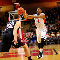 Myles Mack #4 of the Rutgers Scarlet Knights passes the ball away from Dalton Pepper #32 of the Temple Owls during the second half of Rutgers men's basketball vs Temple Owls in American Athletic Conference play on Jan. 1, 2014 at Rutgers Louis Brown Athletic Center in Piscataway, New Jersey.