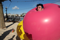 New York clown duo Acrobuffos performing part of Air Play, part of Southbank Centre's Festival of Love from August 9 to 14, on the Centre's so-called Copacobana Beach. The duo, Seth Bloom and Christina Gelsone, will be performing displays with flying umbrellas, balloons and kites.