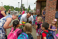 Elm Street School kindergarten teacher Mrs. Berthiaume introduces Principal Kevin Michaud to her students Kendora Harper, Jaelyn Nialetz and Jacob Toomey on their first day of school Tuesday morning.   (Karen Bobotas/for the Laconia Daily Sun)