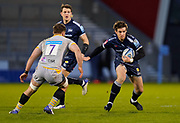 Sale Sharks fly-half AJ McGinty steps inside Wasps flanker Thomas Young during the Gallagher Premiership Rugby match Sale Sharks -V- Wasps  at The AJ Bell Stadium, Greater Manchester, England United Kingdom, Sunday, December 27, 2020. (Steve Flynn/Image of Sport)
