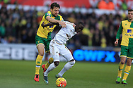 Modou Barrow of Swansea city is challenged by Russell Martin of Norwich city.Barclays Premier league match, Swansea city v Norwich city at the Liberty Stadium in Swansea, South Wales  on Saturday 5th March 2016.<br /> pic by  Andrew Orchard, Andrew Orchard sports photography.