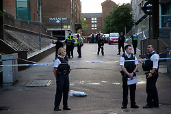 © Licensed to London News Pictures. 10/07/2020. London, UK. Police officers guard a crime scene at Crossharbour DLR station in Poplar. Police were called shortly after 18:00hrs to reports of two males injured at Alexia Square, E14 close to Crossharbour DLR station. Officers attended and found a man, believed aged in his late teens or early 20s, suffering stab injuries. Emergency services provided first aid but despite their efforts, he was pronounced dead at the scene. A second male, believed aged in his late teens, was taken by the LAS to an east London hospital. Photo credit: George Cracknell Wright/LNP