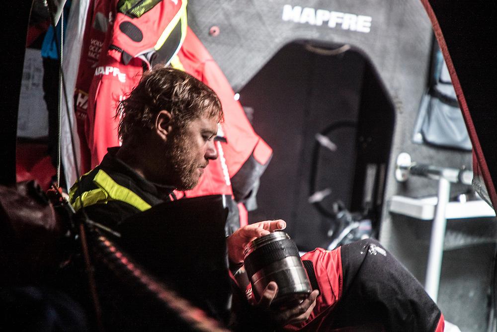 Leg 02, Lisbon to Cape Town, day 16, on board MAPFRE, Antonio Cuervas-Mons having lunch. Photo by Ugo Fonolla/Volvo Ocean Race. 20 November, 2017