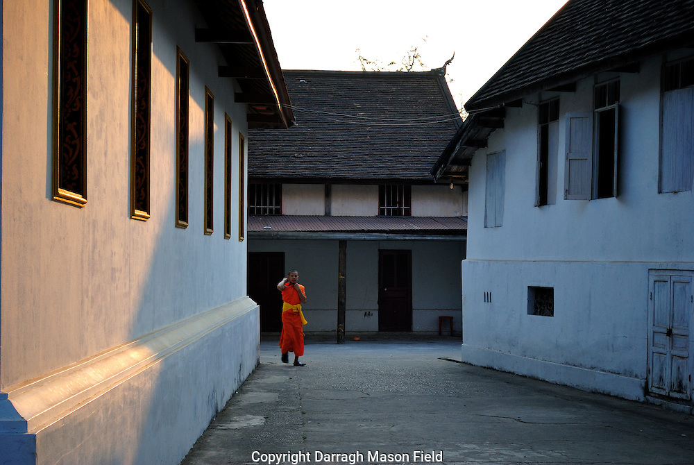 Novice monk on route to evening prayer