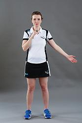 Umpire Louise Travis signalling throw in - goal line