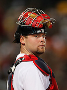 ATLANTA - AUGUST 7:  Catcher Brian McCann #16 of the Atlanta Braves looks in the dugout between innings during the game against the San Francisco Giants at Turner Field on August 7, 2010 in Atlanta, Georgia.  The Braves beat the Giants 3-0.  (Photo by Mike Zarrilli/Getty Images)