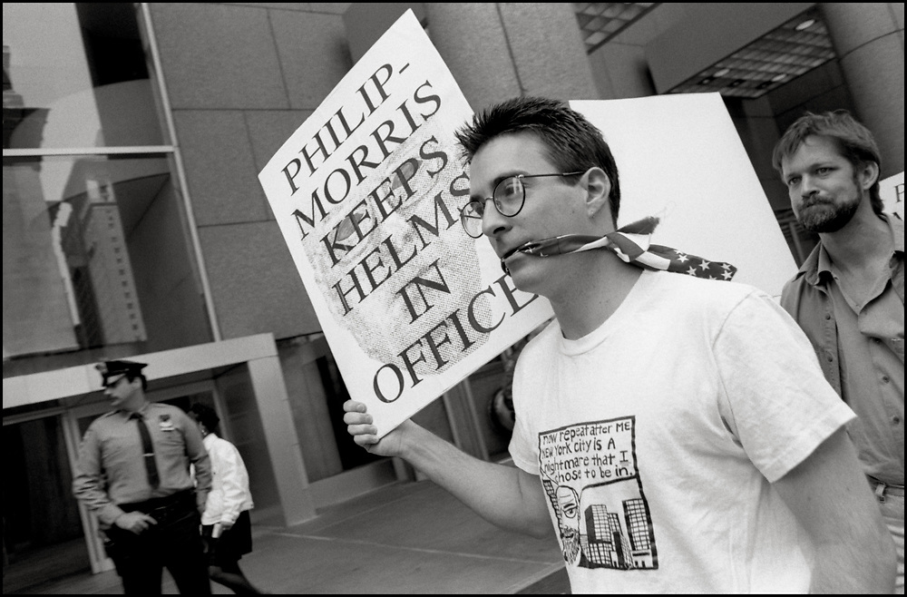 ACT UP picked the Park Avenue offices of Philip Morris International in May of 1990 to protest the company's support of Senator Jesse Helms (R-North Carolina), a leading opponent of AIDS funding and civil rights for lesbian, gay, bisexual and transgender (LGBT) people. ACT UP demanded that Philip Morris sever its ties with Helms and acknowledge its responsibility to the LGBT community and to people with AIDS.<br /> <br /> 1990 ACT UP sparked a year long boycott of Philip Morris's Marlboro cigarettes and Miller beer.