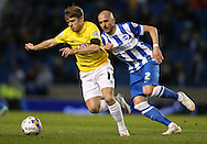 Jamie Ward gets away from Bruno Saltor, Brighton defender during the Sky Bet Championship match between Brighton and Hove Albion and Derby County at the American Express Community Stadium, Brighton and Hove, England on 3 March 2015.