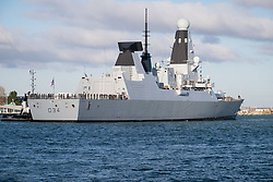 © Licensed to London News Pictures. 01/12/2017. Portsmouth, UK.  The troubled Royal Navy Type-45 Destroyer, HMS Diamond, returning to Portsmouth with a tug escort following 'technical issues'. The £1 billion Daring-class warship has returned home early from her patrol on Operation Kipion in the Gulf. Photo credit: Rob Arnold/LNP