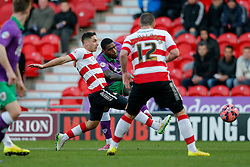 Jay Emmanuel-Thomas of Bristol City shoots as Dean Furman of Doncaster Rovers challenges - Photo mandatory by-line: Rogan Thomson/JMP - 07966 386802 - 03/01/2015 - SPORT - FOOTBALL - Doncaster, England - Keepmoat Stadium - Doncaster Rovers v Bristol City - FA Cup Third Round Proper.
