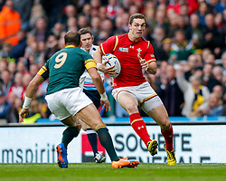 Wales Winger George North is challenged by South Africa Scrum-Half Fourie du Preez (capt) - Mandatory byline: Rogan Thomson/JMP - 07966 386802 - 17/10/2015 - RUGBY UNION - Twickenham Stadium - London, England - South Africa v Wales - Rugby World Cup 2015 Quarter Finals.
