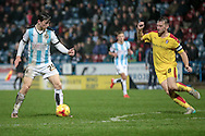Ben Chilwell (Huddersfield Town) gets ready to offload the ball as Lee Frecklington (captain) (Rotherham United) closes in during the Sky Bet Championship match between Huddersfield Town and Rotherham United at the John Smiths Stadium, Huddersfield, England on 15 December 2015. Photo by Mark P Doherty.