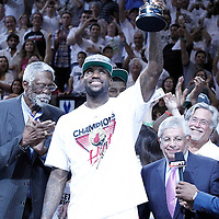 21 June 2012: Miami Heat small forward LeBron James (6) celebrates holding the NBA Finals MVP trophy next to Bill Russell and David Stern after the Miami Heat 121-106 victory over the Oklahoma City Thunder, in Game 5 of the 2012 NBA Finals, at the AmericanAirlinesArena, Miami, Florida, USA. The Miami Heat wins the series 4-1.