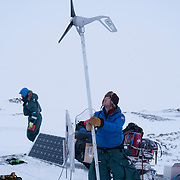 BJ Kirschhoffer works on the wind turbine used to produce electricity for a remote polar bear den camera. Svalbard, Norway