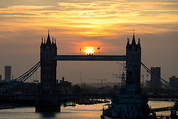 © Licensed to London News Pictures. 17/10/2017. London, UK. The sun rises over Tower Bridge in London. Yesterday, the UK and Ireland experienced high winds and unusual weather due to the remnants of hurricane Ophelia. Photo credit : Tom Nicholson/LNP