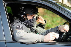 © Licensed to London News Pictures. 23/04/2016. An armed anti-terrorism police unit patrolling The Grove golf Course where President of The United States of America, BARAK OBAMA, played golf with British prime minister DAVID CAMERON . Photo credit: Ben Cawthra/LNP