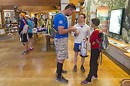 Cragsmoor, New York -  Runners hang out in the conservation center at Sam's Point Preserve before competing  in the Shawangunk Ridge Trail Run/Hike 32-mile race on Sept. 20, 2014.