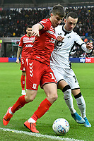 Football - 2019 / 2020 Sky Bet (EFL) Championship - Swansea City vs. Middlesbrough<br /> <br /> Paddy McNair of Middlesbrough & Bersant Celina of Swansea City, at The Liberty Stadium.<br /> <br /> COLORSPORT/WINSTON BYNORTH