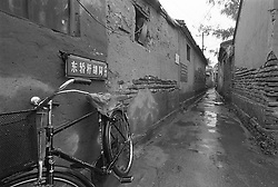 Bicycle parked in an old narrow Beijing hutong