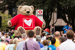 © Licensed to London News Pictures. 07/07/2014. London, UK. A giant bear passes down the street near Tower Bridge ahead of the Tour de France stage 3 in London. Photo credit : Vickie Flores/LNP