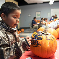 Kevin paints a pumpkin Wednesday afternoon at the Office of Diné Youth in Fort Defiance during a special event of pumpkin carving or painting to celebrate Halloween. Kindergarten through third grade painted pumpkins and fourth graders and up carved pumpkins.