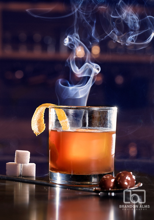 A smoked old fashioned cocktail from Missouri Spirits located in Springfield, MO. Photo by Brandon Alms Photography