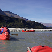 People on the Dart River Funyak Safari with Dart River Jet Safaris. The  unique adventure combines exhilarating wilderness jet boating with unique Funyak inflatable canoes used to explore the magnificent World Heritage wilderness within Mt Aspiring National Park. Professional guides take participants through dramatic landscapes, paddling along channels of the glacier fed Dart River's braided river system as well as along hidden side streams, rock pools and dramatic chasms. The tour is based at Glenorchy and provides transport from Queenstown, Dart River Safaris. Glenorchy, New Zealand. 13th April 2011. Photo Tim Clayton