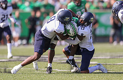 Oct 9, 2021; Huntington, West Virginia, USA; Marshall Thundering Herd wide receiver Jayden Harrison (2) catches a pass and is tackled by Old Dominion Monarchs linebacker Ryan Henry (8) and Old Dominion Monarchs safety Terry Jones (13) during the second quarter at Joan C. Edwards Stadium. Mandatory Credit: Ben Queen-USA TODAY Sports