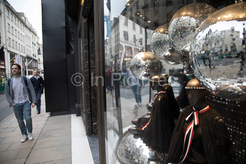 Exclusive clothes shop window for Moncler on New Bond Street in Mayfair, London, England, United Kingdom. Bond Street is one of the principal streets in the West End shopping district and is very upmarket. It has been a fashionable shopping street since the 18th century. The rich and wealthy shop here mostly for high end fashion and jewellery.