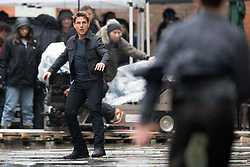Tom Cruise braves the London rain to film a foot chase scene for Mission Impossible - Fallout, in Central London. Between takes Tom could be seen under an umbrella talking to director Christopher McQuarrie. 10 Feb 2018 Pictured: Tom Cruise. Photo credit: MEGA TheMegaAgency.com +1 888 505 6342
