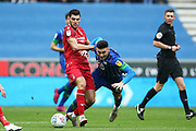 Nottingham Forest forward Rafa Mir (14) gets the tackle on Wigan Athletic forward Kieffer Moore (19) during the EFL Sky Bet Championship match between Wigan Athletic and Nottingham Forest at the DW Stadium, Wigan, England on 20 October 2019.