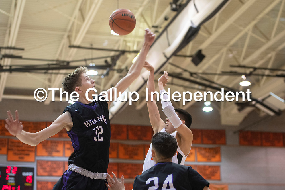 Miyamura Patriot Christopher Mortensen (32) blocks a shot by Gallup Bengal Quinn Atazhoon (24) Wednesday night at Gallup High School in Gallup. Gallup took the win 56-51.