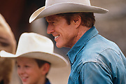 """LIVINGSTON, MT - AUGUST:  Robert Redford watches the round up during the filming of """"The Horse Whisperer"""" in 1997. (Photo by John Kelly/Getty Images)"""