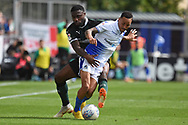Yann Songo'o (4) of Plymouth Argyle fouls Kyle Bennett (23) of Bristol Rovers during the EFL Sky Bet League 1 match between Bristol Rovers and Plymouth Argyle at the Memorial Stadium, Bristol, England on 8 September 2018.
