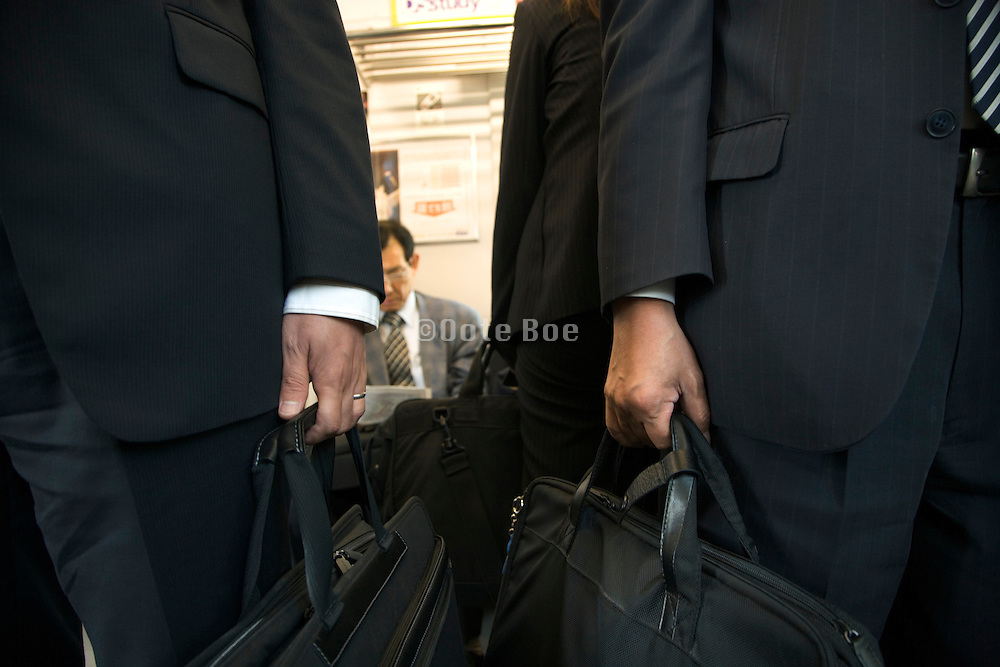 business commuters in a Tokyo subway