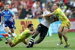 April 29, 2018 - Singapore - Kalione Nasoko (centre) of Fiji is tackled by Bradon Quinn (left) and John Porch of Australia during the Cup Final match between Fiji and Australia at the Rugby Sevens tournament at the National Stadium. Singapore. (Credit Image: © Paul Miller via ZUMA Wire)