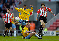 Photo. Glyn Thomas, Digitalsport<br /> NORWAY ONLY<br /> <br /> Sunderland v Crystal Palace, Nationwide League Division One Playoff Semi-finals Second Leg, 16/05/2004.<br /> Palace's Wayne Routledge (L) and Sunderland's John Oster (R) have to hurdle over Palace's Aki Riihilahti.