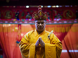 September 4, 2017 - Bangkok, Thailand - A Chinese Buddhist monk leads a prayer at Chaomae Thapthim Shrine. About 1,000 people came to the shrine for the annual food distribution. Staples, like rice and cooking oil, are donated to the shrine throughout the year and donated to poor people from the communities around the shrine. Food distributions like this are a tradition at Chinese shrines in Bangkok and a common way of making merit for the people who donate the staples. (Credit Image: © Sean Edison via ZUMA Wire)