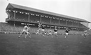 All Ireland Senior Football Final Galway v. Dublin 22nd September 1963 Croke Park...Foley (left) Dublin Full Back fists ball pressed by Cleary, Galway ..22.09.1963  22nd September 1963