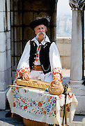 Hungarian man in traditional clothing with Hungarian musical instrument in Budapest, Hungary
