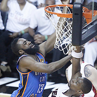 21 June 2012: Oklahoma City Thunder guard James Harden (13) goes for the layup against Miami Heat power forward Chris Bosh (1) during the Miami Heat 121-106 victory over the Oklahoma City Thunder, in Game 5 of the 2012 NBA Finals, at the AmericanAirlinesArena, Miami, Florida, USA. The Miami Heat wins the series 4-1.