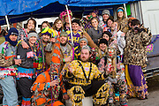 Cajun Mardi Gras participants pose for a group photo during the Courir de Mardi Gras chicken run on Fat Tuesday February 17, 2015 in Eunice, Louisiana. Cajun Mardi Gras involves costumed revelers competing to catch a live chicken as they move from house to house throughout the rural community.