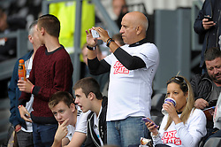 Derby fan takes a photo on his phone  - Photo mandatory by-line: Dougie Allward/JMP - Mobile: 07966 386802 30/08/2014 - SPORT - FOOTBALL - Derby - iPro Stadium - Derby County v Ipswich Town - Sky Bet Championship