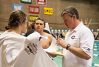 Concord's Jacob Rhodes and Logan Lamb talk with Coach Quinn during the NHIAA Division I Swimming and Diving Championships at UNH Sunday afternoon.  (Karen Bobotas/for the Concord Monitor)